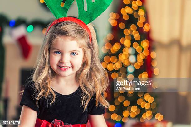 Pretty little girl with Christmas antlers on her headband
