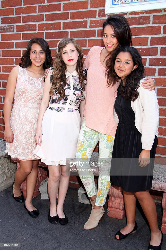 'Pretty Little Liars' star <a gi-track='captionPersonalityLinkClicked' href=/galleries/search?phrase=Shay+Mitchell&family=editorial&specificpeople=6886213 ng-click='$event.stopPropagation()'>Shay Mitchell</a> (2nd R) joins Girl Power Day to give Ascension's 2013 Graduating Class new horizons held at Ascension Catholic School on May 2, 2013 in Los Angeles, California.