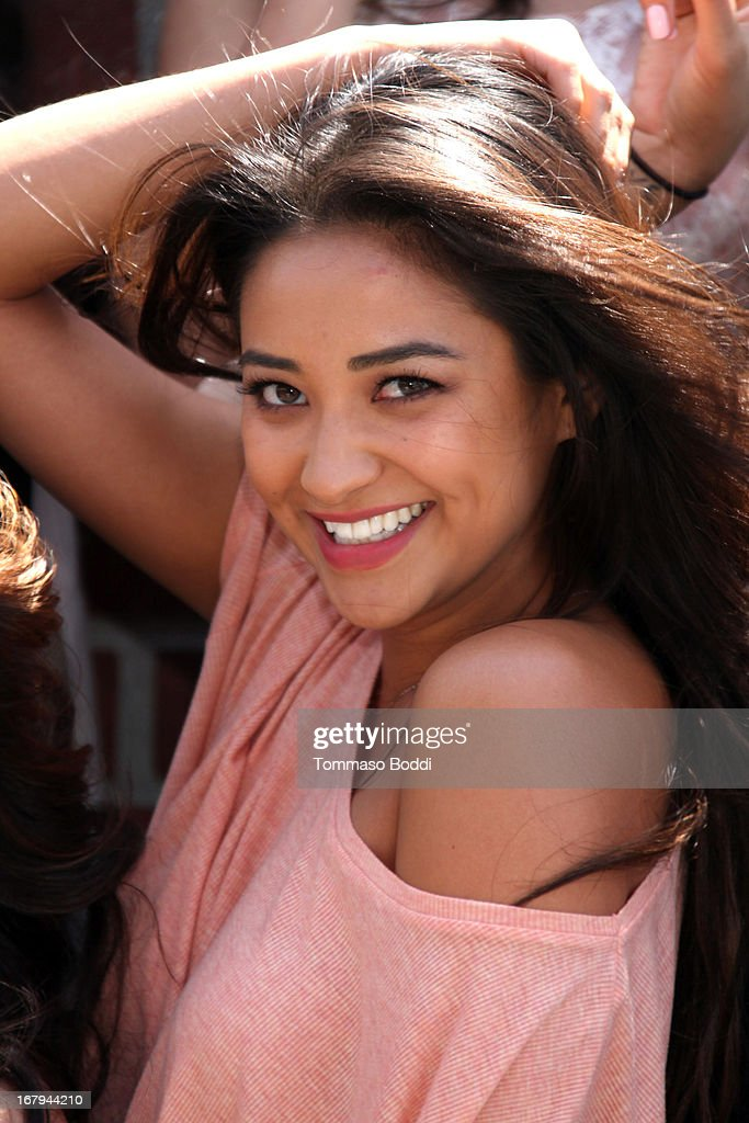 'Pretty Little Liars' star <a gi-track='captionPersonalityLinkClicked' href=/galleries/search?phrase=Shay+Mitchell&family=editorial&specificpeople=6886213 ng-click='$event.stopPropagation()'>Shay Mitchell</a> joins Girl Power Day to give Ascension's 2013 Graduating Class new horizons held at Ascension Catholic School on May 2, 2013 in Los Angeles, California.