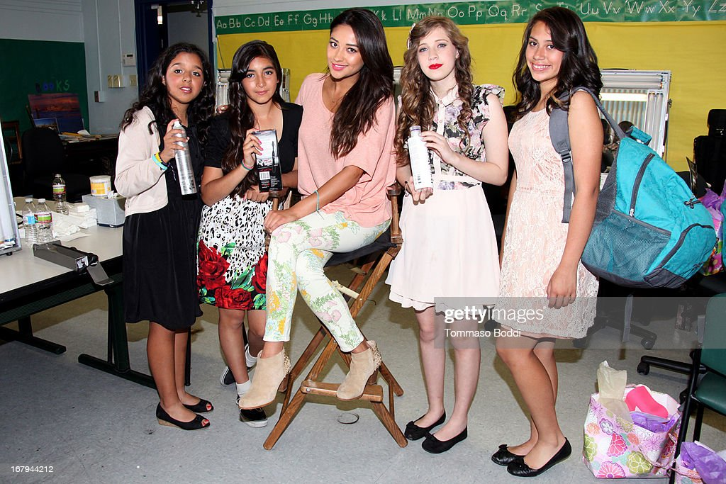 'Pretty Little Liars' star <a gi-track='captionPersonalityLinkClicked' href=/galleries/search?phrase=Shay+Mitchell&family=editorial&specificpeople=6886213 ng-click='$event.stopPropagation()'>Shay Mitchell</a> (C) joins Girl Power Day to give Ascension's 2013 Graduating Class new horizons held at Ascension Catholic School on May 2, 2013 in Los Angeles, California.