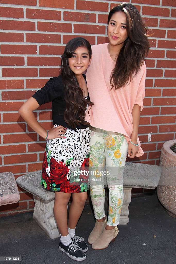 'Pretty Little Liars' star <a gi-track='captionPersonalityLinkClicked' href=/galleries/search?phrase=Shay+Mitchell&family=editorial&specificpeople=6886213 ng-click='$event.stopPropagation()'>Shay Mitchell</a> (R) joins Girl Power Day to give Ascension's 2013 Graduating Class new horizons held at Ascension Catholic School on May 2, 2013 in Los Angeles, California.