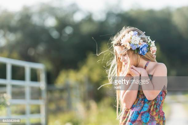 Pretty little stylish girl with flowers in her hair