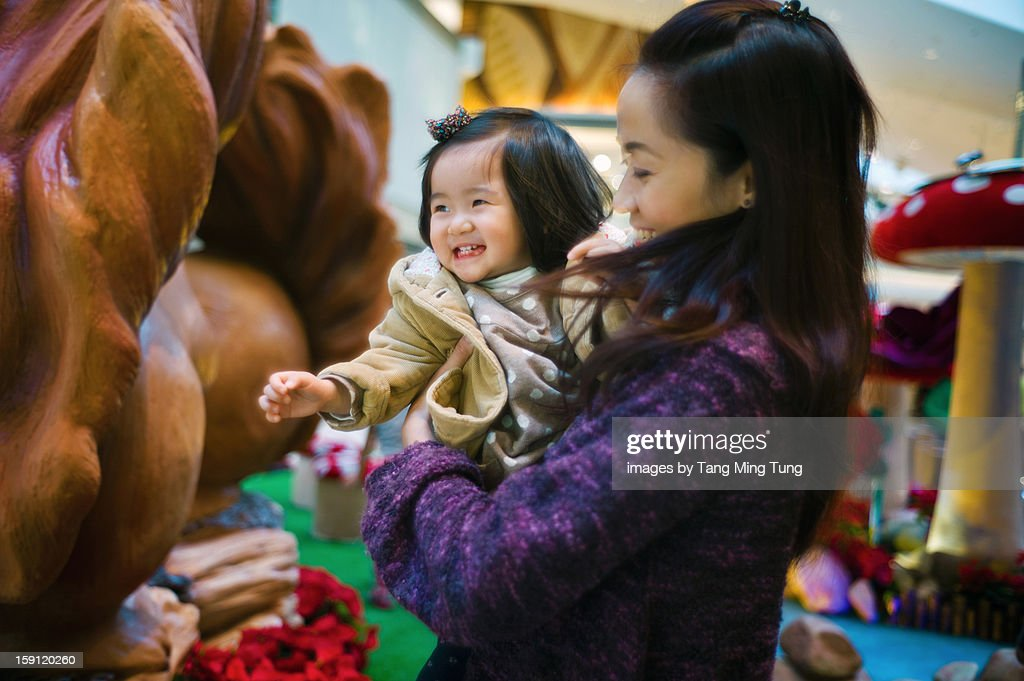 pretty mom holding & playing with cheerful baby : Stock Photo