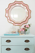 Pretty pastel blue and pink styled dressing table bedroom decor with flowers and mirror