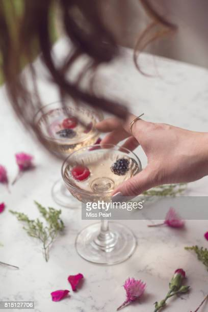 Pretty pink party drinks with flowers and berries