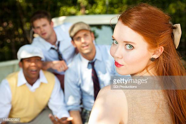 Pretty Red Headed Girl Deciding Which Suitor to Choose