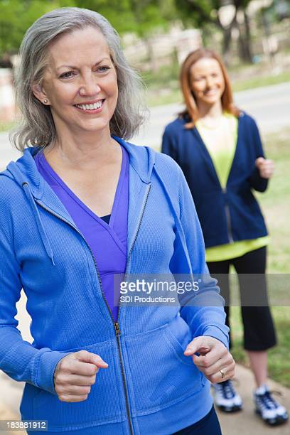 Pretty Senior Adult Woman Walking at a Park