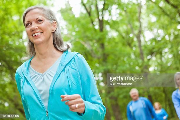 Pretty senior woman walking in park