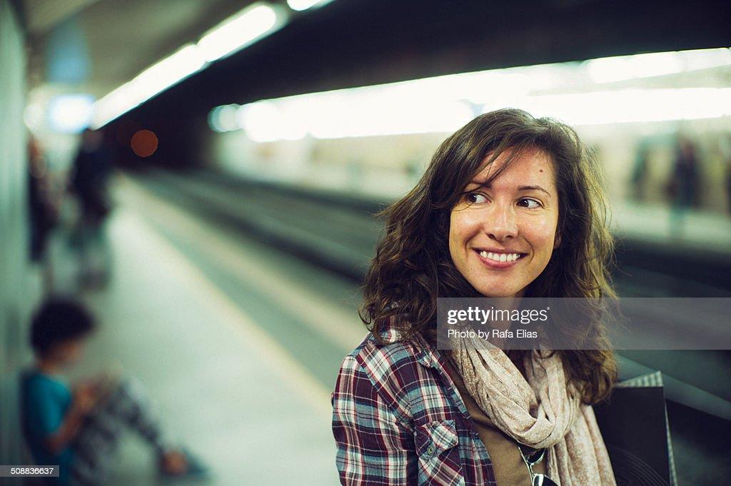 Pretty smiling woman at subway station