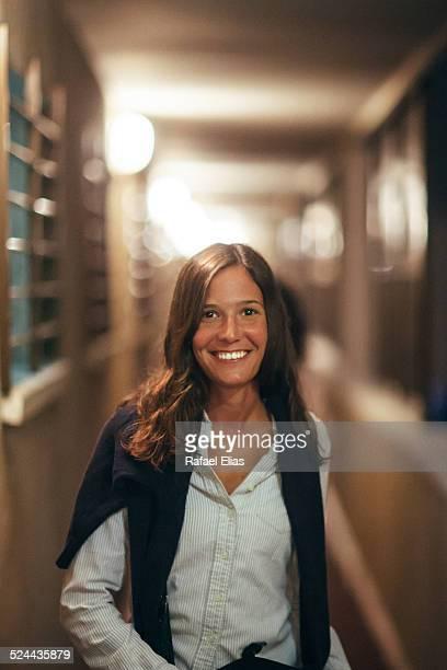 Pretty smiling woman in corridor