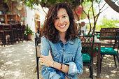 Pretty smiling woman in terrace bar