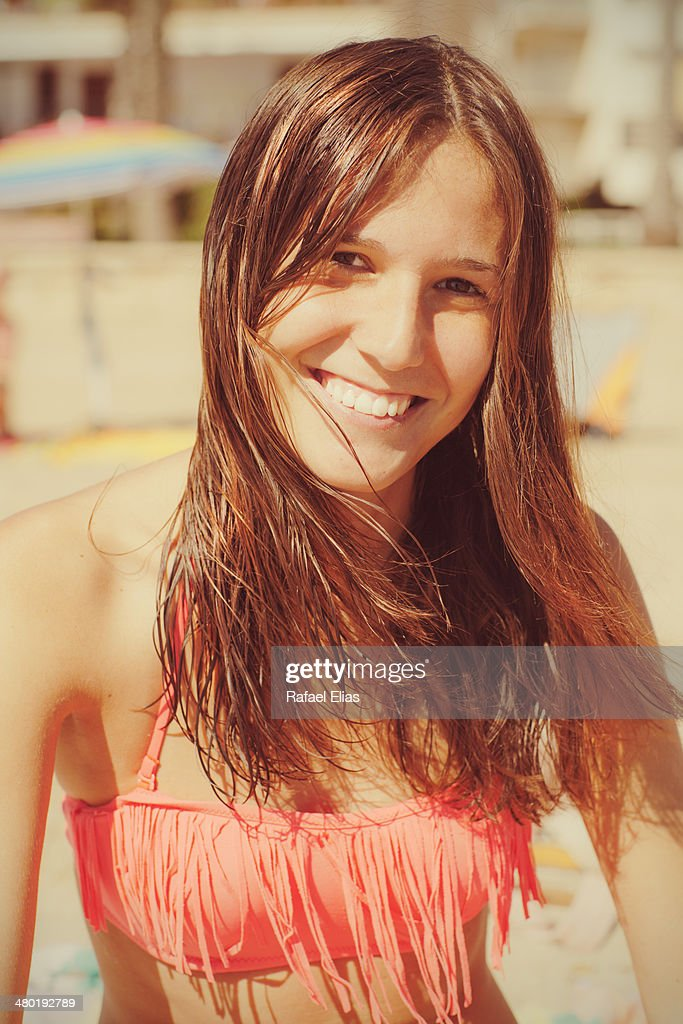Pretty smiling woman on the beach : Stock Photo
