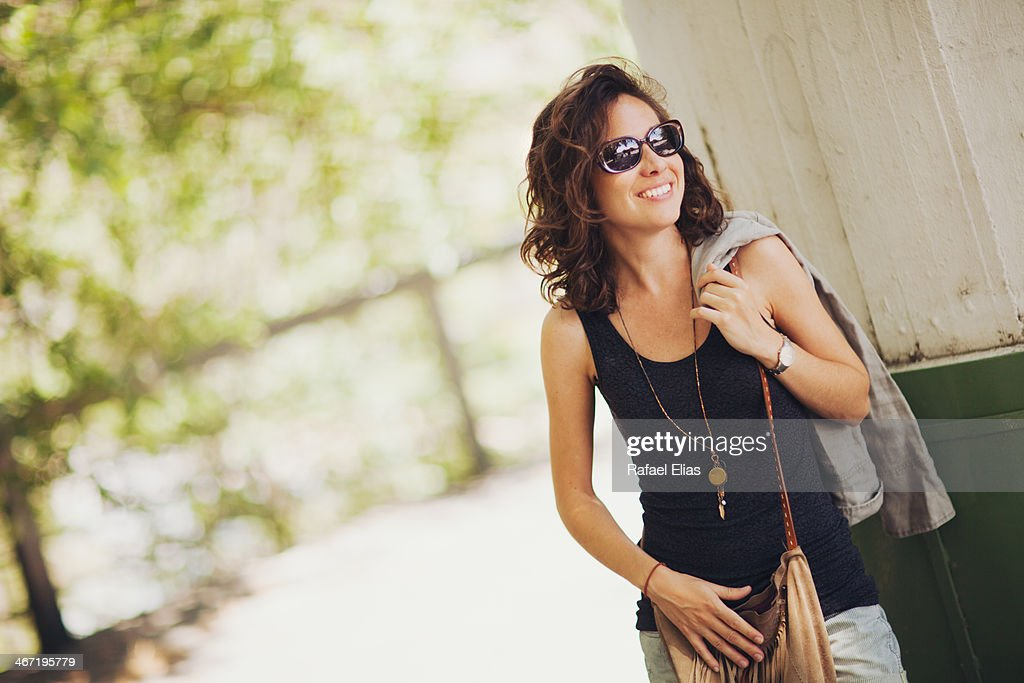 Pretty smiling woman outdoor : Stock Photo