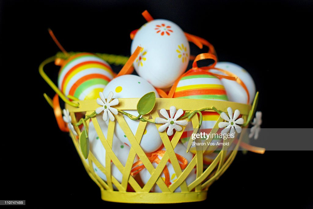 Pretty spring basket full of decorated Easter eggs : Stock Photo