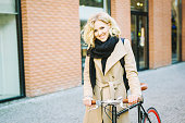 Pretty Stylish Blond Girl With A Bicycle