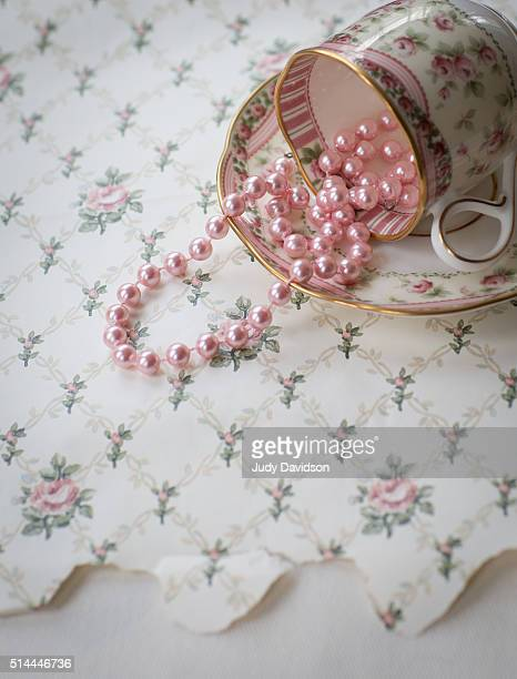 Pretty tipped teacup filled with pink pearls