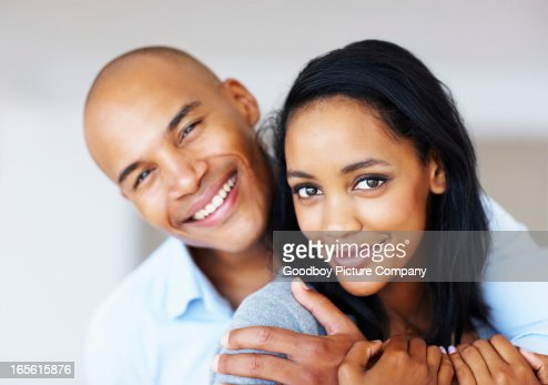 Pretty woman being embraced by her boyfriend