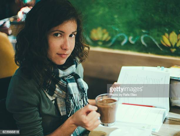 Pretty woman holding cup of hot chocolate