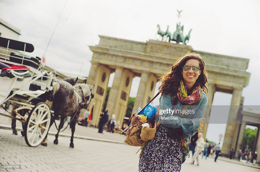 Pretty woman in front of Brandenburg gate