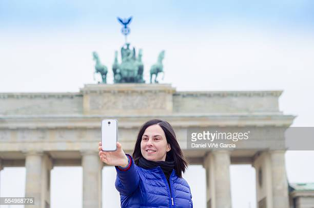 Pretty woman in front of Brandenburg gate