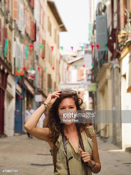 Pretty woman in the street during local holidays