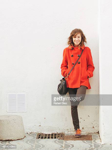 Pretty woman leaning on wall