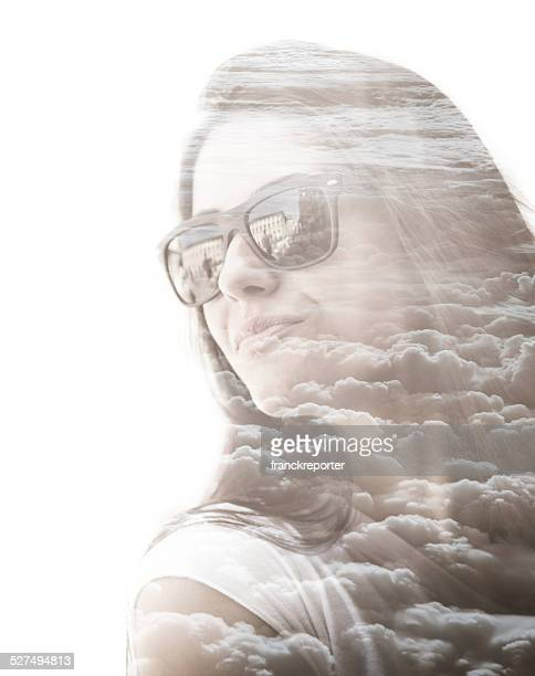 pretty woman looking away on the clouds