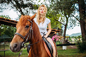 Pretty woman on a horse