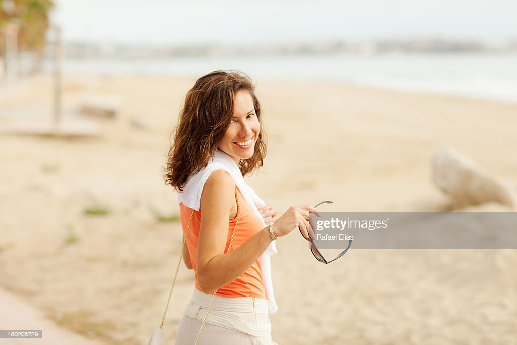 Pretty woman on the beach : Stock Photo