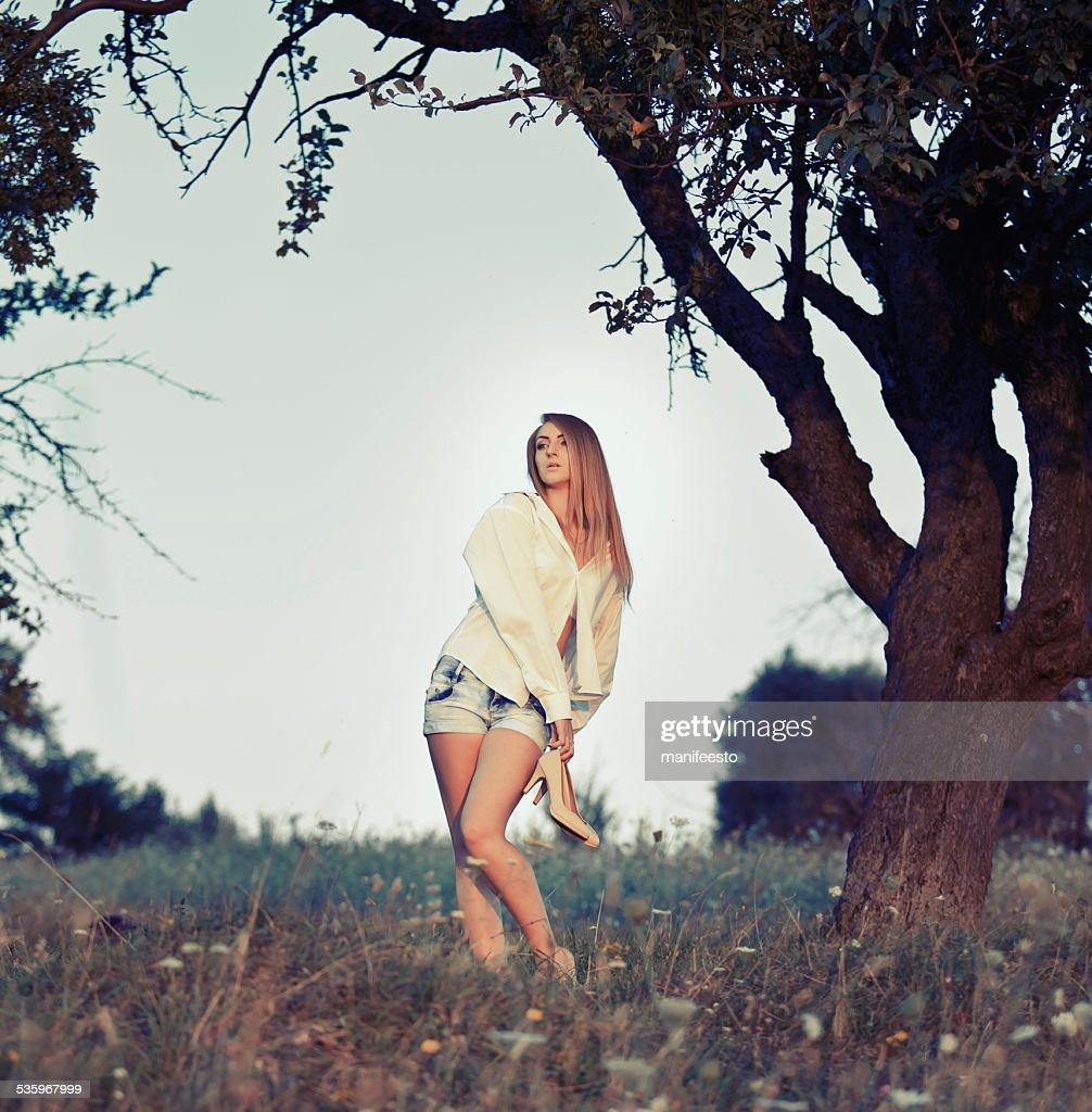 Pretty woman posing outside in summer garden. : Stock Photo