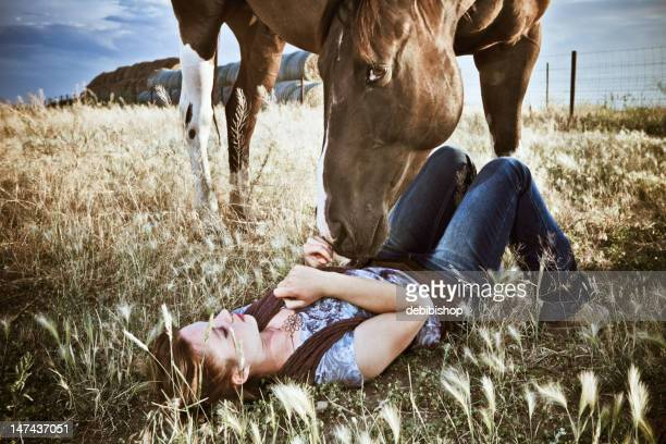 Pretty Woman Relaxing With Her Horse