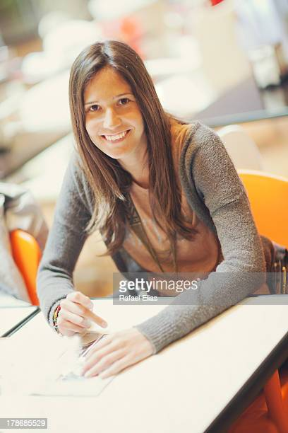 Pretty woman sitting at table