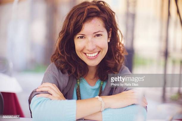 Pretty woman smiling with crossed arms
