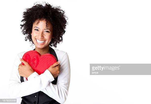 pretty woman squeezing Valentine box in her arms