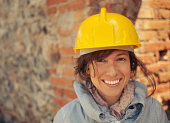 Pretty woman wearing safety helmet