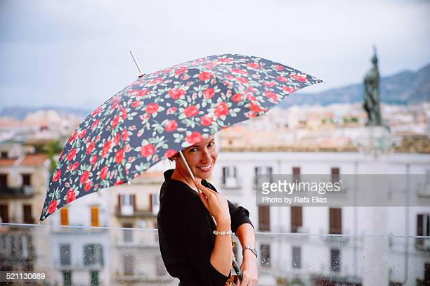 Pretty woman with floral umbrella