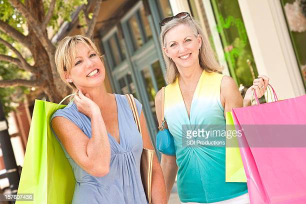 Pretty Women Out Shopping at Outdoor Shops