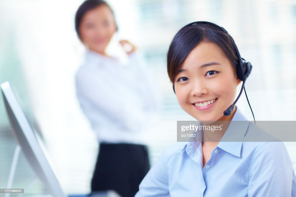 pretty young asian customer service at work