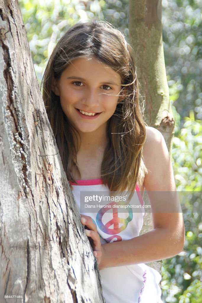 Pretty Young Girl Near Tree Stock Photo | Getty Images