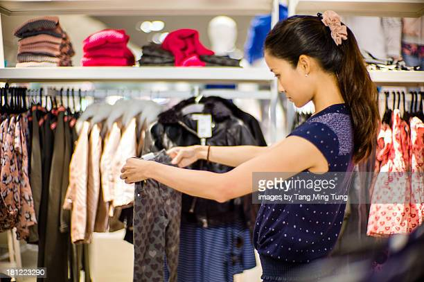 Pretty young lady shopping in a boutique