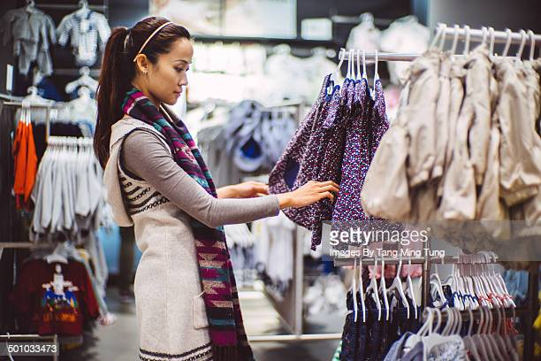 Pretty young lady shopping in department store