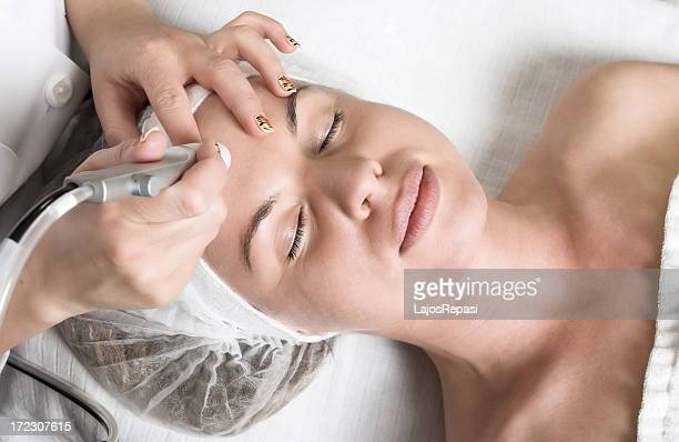 Pretty young woman having relaxing vitalizing face treatment