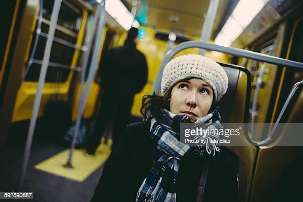 Pretty young woman in train wagon