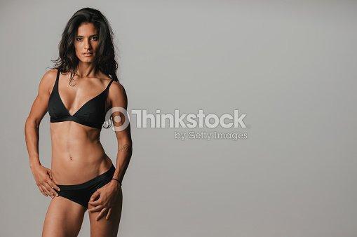 9097b68152e Pretty young woman wearing sexy black underwear   Stock Photo