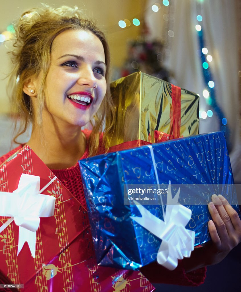 Pretty young woman with gifts. : Stock-Foto