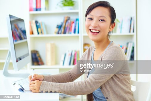 pretty young woman working in home office stock photo
