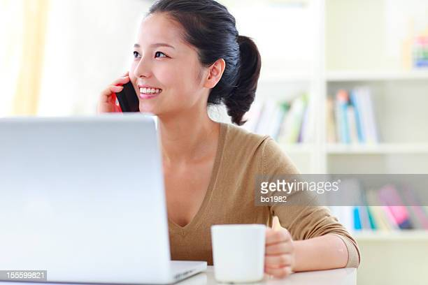 pretty young woman working with laptop indoor