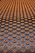 pretzels on conveyor belt in factory