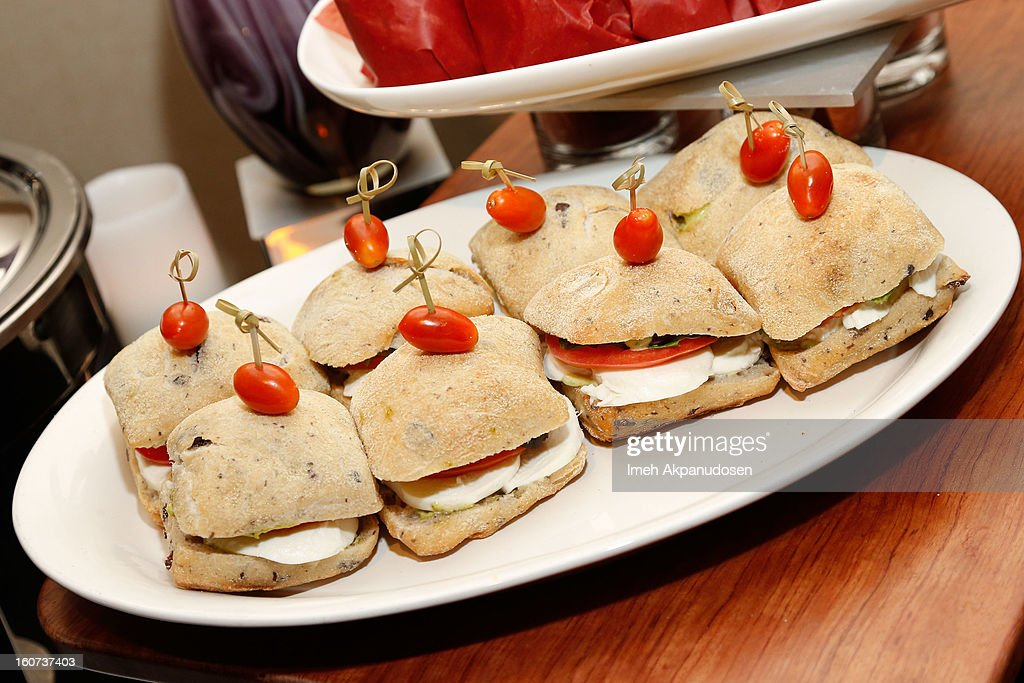 A preview of a Caprese sandwich consisting of mozzarella with basil, E.V.O.O. pesto aioli on 'Rustico' Kalamata olive bread during a behind the scenes kitchen tour and suite menu tasting for the 55th Annual GRAMMY Awards at Staples Center on February 4, 2013 in Los Angeles, California.
