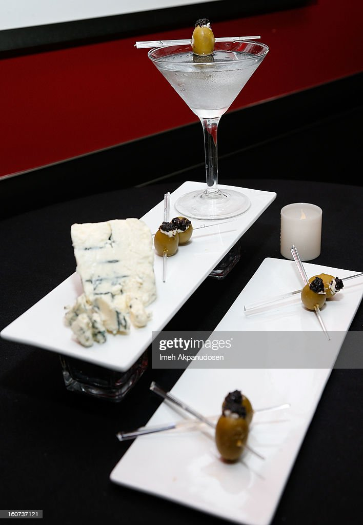 A preview of a Maestro Martini with Chopin Vodka with Point Reyes blue cheese stuffed olives with caviar during a behind the scenes kitchen tour and suite menu tasting for the 55th Annual GRAMMY Awards at Staples Center on February 4, 2013 in Los Angeles, California.